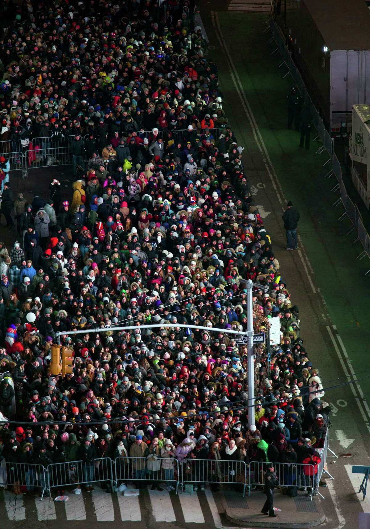 Looking from the Marriott Marquis, people crowd into Times Square for New Year's Eve celebrations in New York Thursday, Dec. 31, 2013.