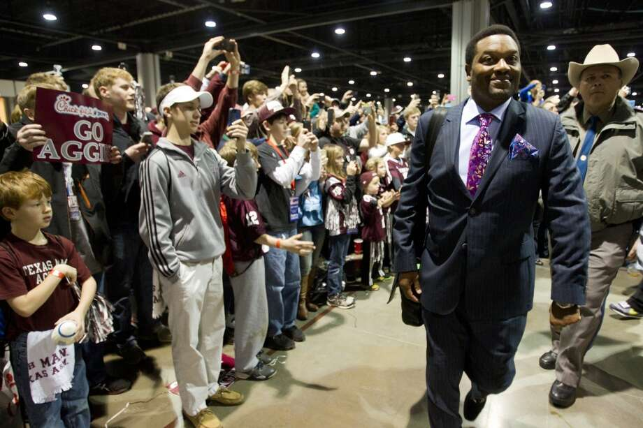 Texas A&M head coach Kevin Sumlin walks past a line of Aggie fans before facing Duke in the Chick-fil-A Bowl. Photo: Brett Coomer, Houston Chronicle