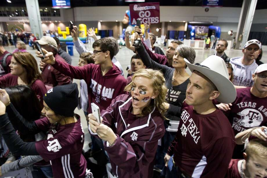 Texas A&M fans cheer as the team walks past them before facing Duke in the Chick-fil-A Bowl. Photo: Brett Coomer, Houston Chronicle