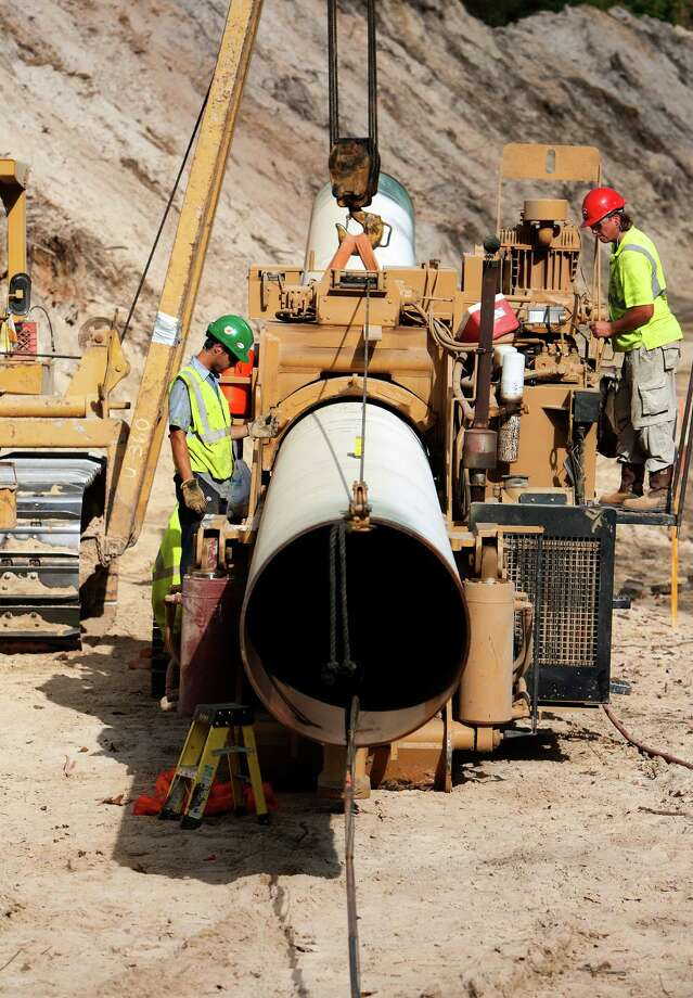 Workers bend a piece of pipe for TransCanada's Keystone XL project in 2012 in Wood County. Photo: Cody Duty, Staff / © 2012 Houston Chronicle