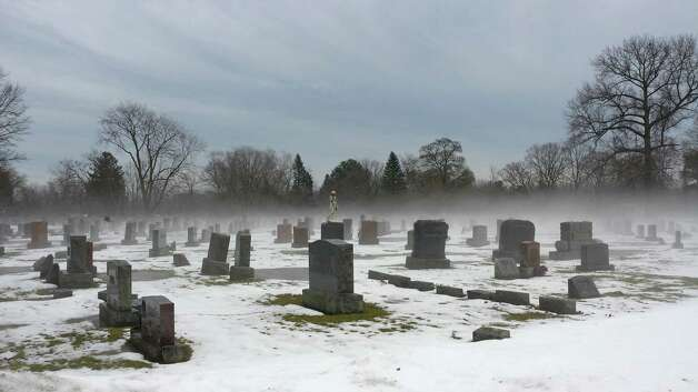 Fog envelops a section of the Graceland Cemetery in Albany on Dec. 22 i this photo by Eric James Platt of Albany.