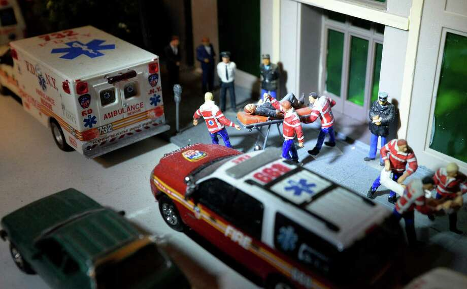 A model EMS scene is depicted Thursday Dec. 26, 2013, at Jim Brown?s home in Menands, N.Y. Brown has an extensive collection of model police, fire and emergency vehicles. His collection includes state police vehicles from all 50 states and vehicles from dozens of sheriff and police departments. (Skip Dickstein / Times Union) Photo: SKIP DICKSTEIN / 0025167A