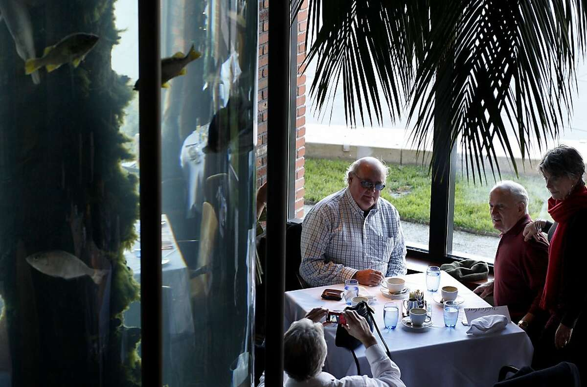 The Waterbar dining room has floor-to-ceiling aquariums. But the best view is outside: the bay.