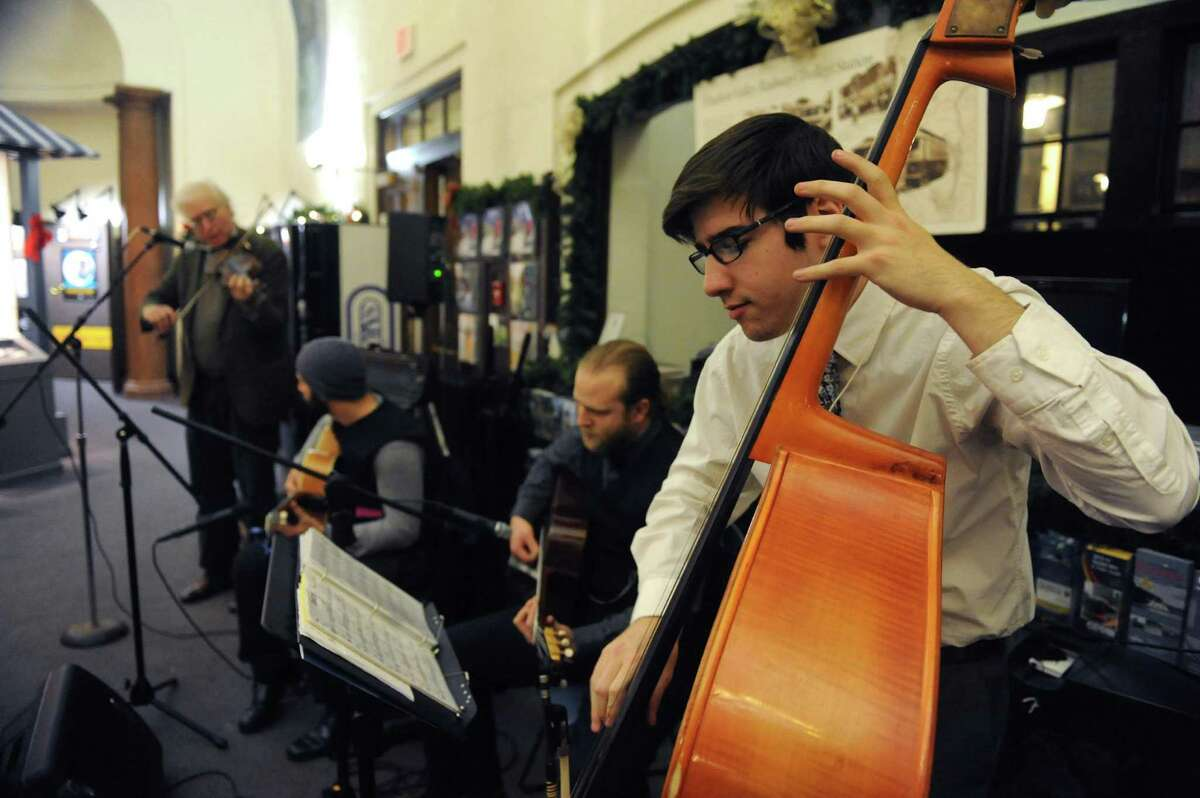 Bassist Mike Jenkins, right, plays with the C.C. Vagabonds at the Saratoga Visitor Center during the Saratoga First Night celebration on Tuesday Dec. 31, 2013 in Saratoga Springs, N.Y. (Michael P. Farrell/Times Union)