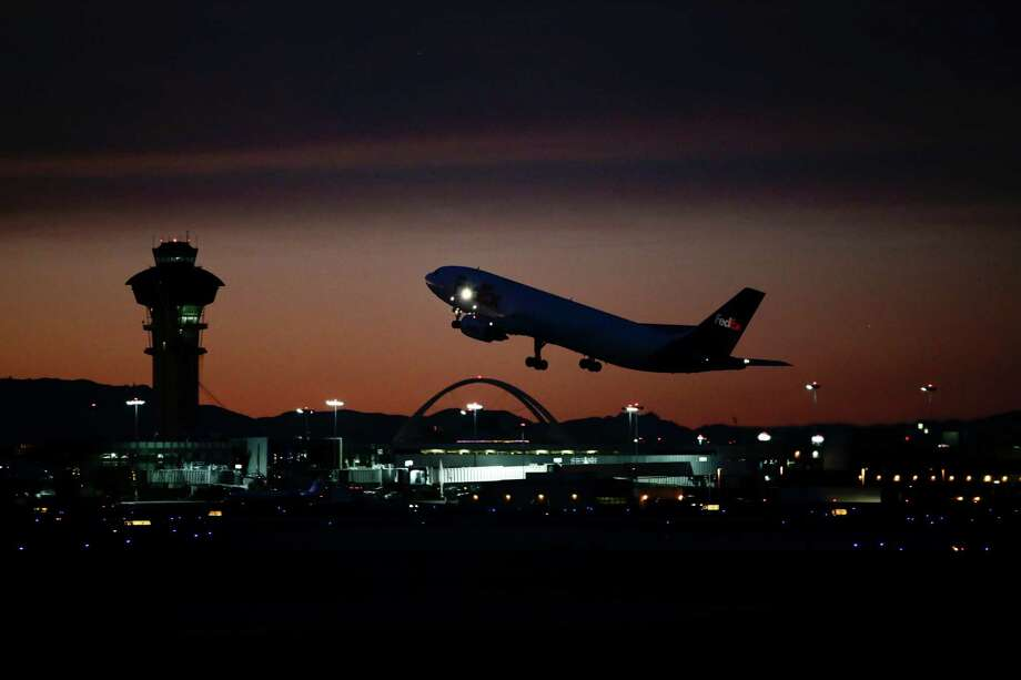 In this Monday, Dec. 2, 2013 photo, a plane takes off from Los Angeles International Airport, in Los Angeles. Jan. 1, 2014, marked the 100th anniversary of the first commercial flight. (AP Photo/Jae C. Hong) Photo: Jae C. Hong, STF / AP