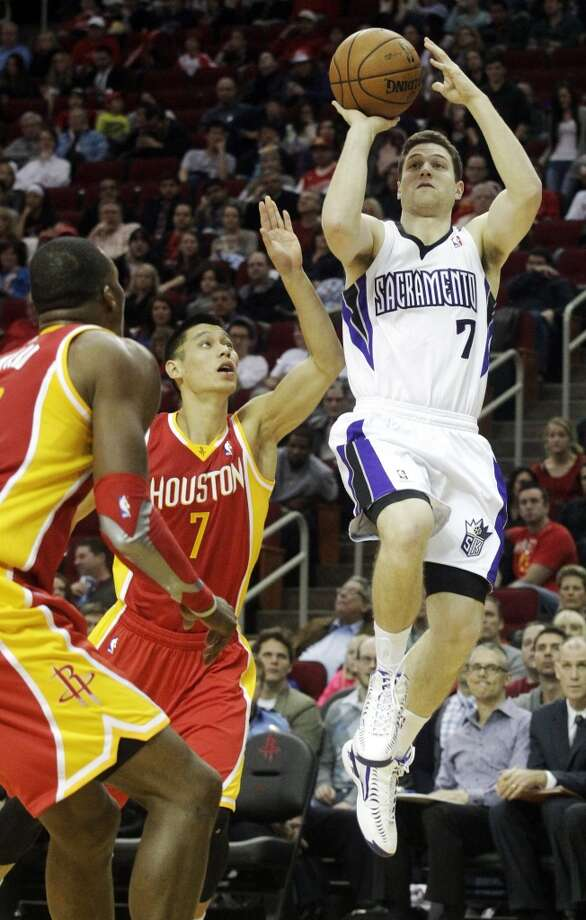 Kings guard Jimmer Fredette attempts a shot against the Rockets. Photo: Patric Schneider, Associated Press