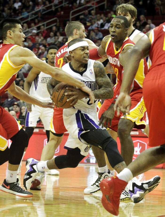 Rockets point guard Jeremy Lin tries to pry the ball away from Isaiah Thomas of the Kings. Photo: Patric Schneider, Associated Press