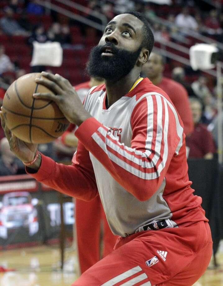 Rockets shooting guard James Harden warms up before facing the Kings. Photo: Patric Schneider, Associated Press