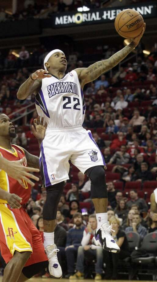 Kings point guard Isaiah Thomas attempts a shot versus the Rockets. Photo: Patric Schneider, Associated Press