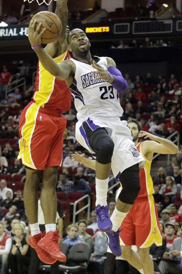 Marcus Thornton of the Kings attempts a shot against the Rockets. Photo: Patric Schneider, Associated Press