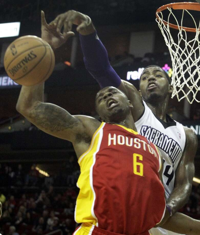 Rockets forward Terrence Jones battles for a rebound with Kings forward Jason Thompson Photo: Patric Schneider, Associated Press