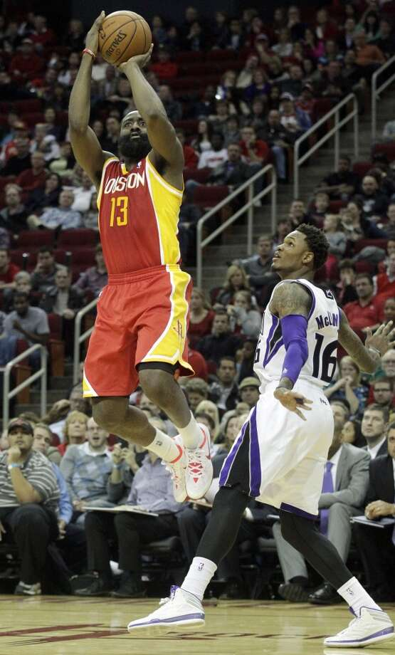 Dec. 31: Kings 110, Rockets 106  Rockets shooting guard James Harden attempts a shot against the Kings. Photo: Patric Schneider, Associated Press