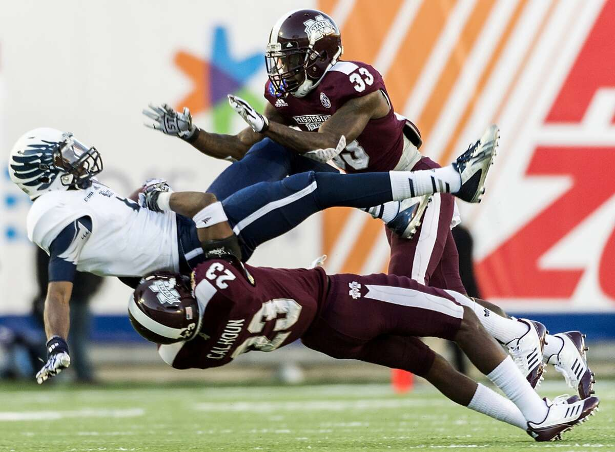 Dec. 31: Mississippi State 33, Rice 7Record: 10-4 Rice wide receiver Dennis Parks (4) is slammed to the turf by Mississippi State defensive back Taveze Calhoun (23) during the first half the 55th AutoZone Liberty Bowl.