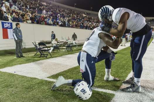 Rice's Malcolm Hill, right, consoles teammate Jeremy Eddington after a loss to Mississippi State. Photo: Smiley N. Pool, Houston Chronicle