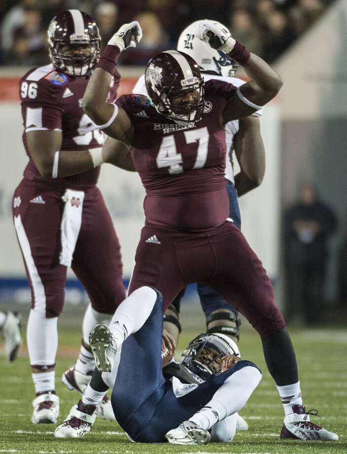 Mississippi State defensive lineman A.J. Jefferson (47) celebrates after Rice quarterback Driphus Jackson, bottom, was sacked by defensive lineman Ryan Brown. Photo: Smiley N. Pool, Houston Chronicle