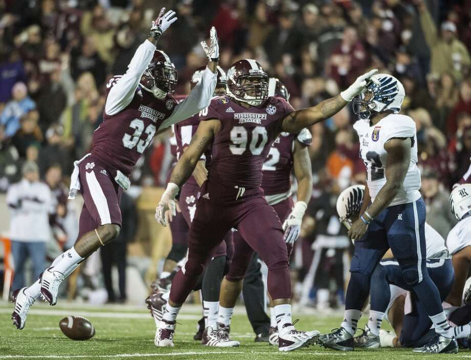 Rice running back Charles Ross (12) walks away as Mississippi State defensive back Kivon Coman (33) and defensive lineman Denico Autry (90) celebrate after recovering a fumble. Photo: Smiley N. Pool, Houston Chronicle