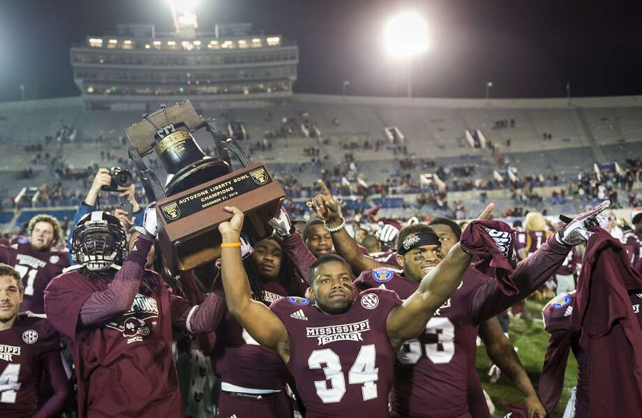 Mississippi State players celebrate with the Liberty Bell Trophy after defeating Rice to win the 55th AutoZone Liberty Bowl. Photo: Smiley N. Pool, Houston Chronicle