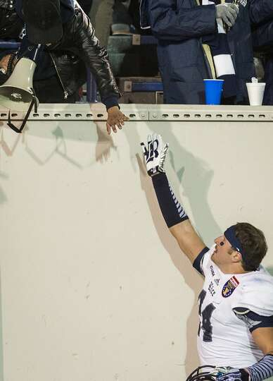 Rice safety Paul Porras gets a hand from the crowd after a loss to Mississippi State.