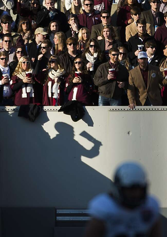 Mississippi State fans ring cowbells as Rice's Luke Turner brings the Owls offense to the line of scrimmage. Photo: Smiley N. Pool, Houston Chronicle