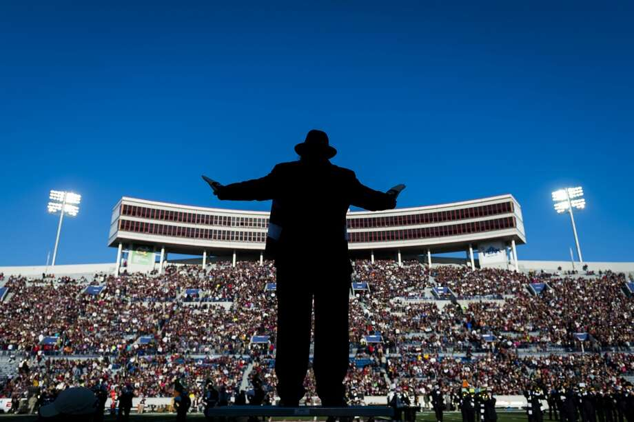 Chuck Throckmorton directs the Marching Owl Band before the Liberty Bowl game. Photo: Smiley N. Pool, Houston Chronicle