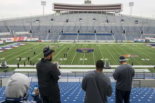 Rice players take photos of the stadium after the team walkthrough at the Liberty Bowl. Photo: Smiley N. Pool, Houston Chronicle