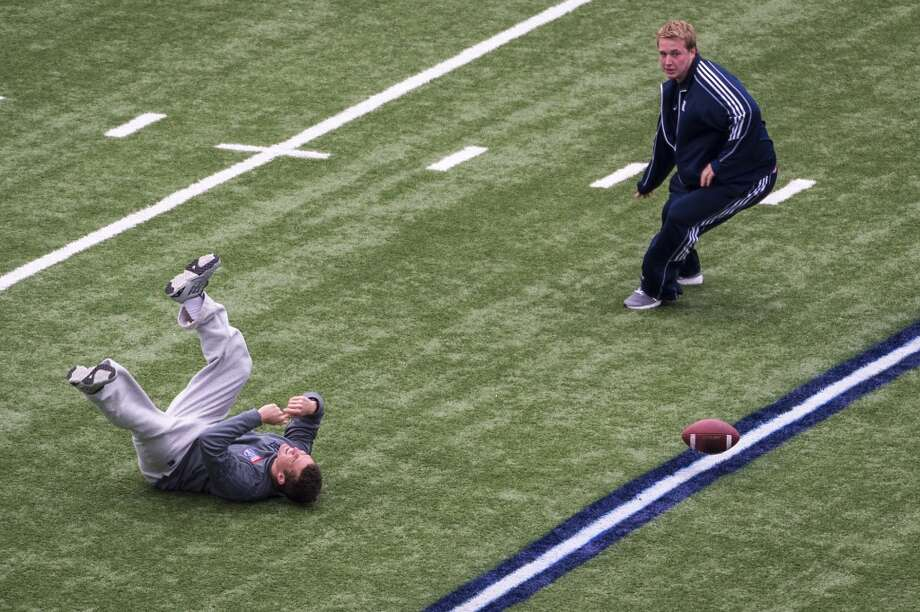 Rice players tumble on the field as they play a lighthearted game of kickball after the team walkthrough at the Liberty Bowl. Photo: Smiley N. Pool, Houston Chronicle