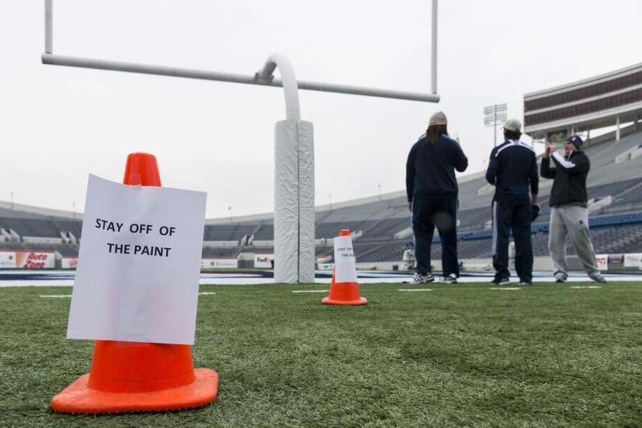 Rice players take photos of the stadium during the team walkthrough at the Liberty Bowl. Photo: Smiley N. Pool, Houston Chronicle