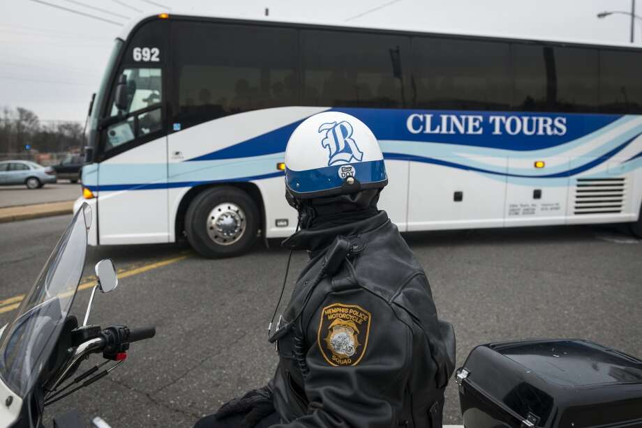 Members of the Memphis Police Motorcycle Squad sport Rice decals on their helmets as they escort the team buses to the team hotel. Photo: Smiley N. Pool, Houston Chronicle