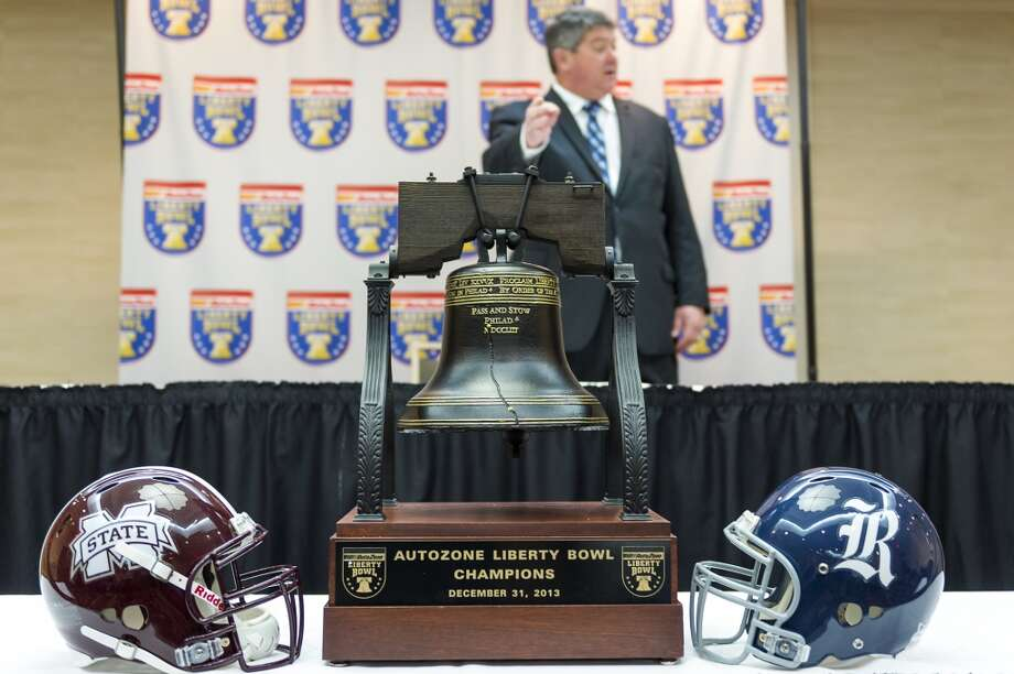 Rice head coach David Bailiff points to the trophy as he arrives for a press conferences in advance of the 55th AutoZone Liberty Bowl. Photo: Smiley N. Pool, Houston Chronicle