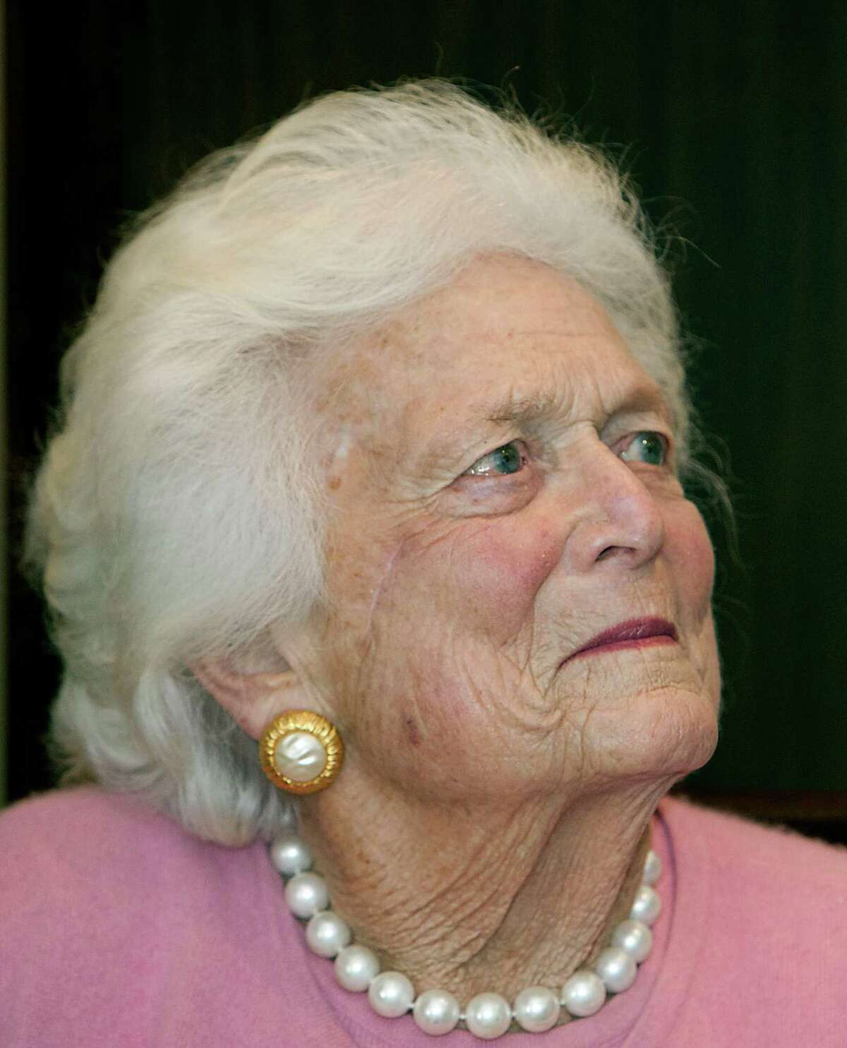 Former First Lady Barbara Bush during a ceremony presenting the 5115th Daily Point of Light (DPOL) Award to Jim McIngvale at President Bush's office Monday, Dec. 23, 2013, in Houston. ( James Nielsen / Houston Chronicle )