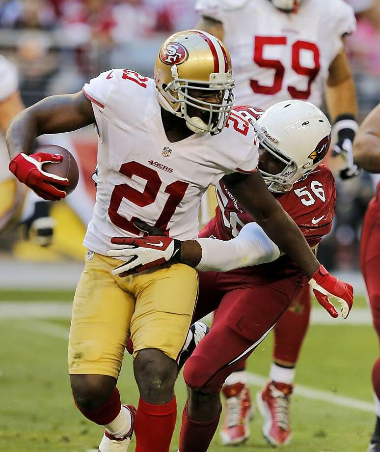 Frank Gore gained only 14 yards Sunday against the Cardinals, above, but ran for 119 yards against the Packers in last January's playoff win at Candlestick. Photo: Rick Scuteri, Associated Press