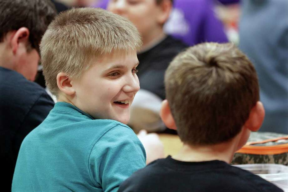 Jackson Cunningham, 11, talks with his classmates during lunch at school. Jackson corresponded with Sen. Mark Kirk during his stroke recovery. Photo: Seth Perlman, STF / AP