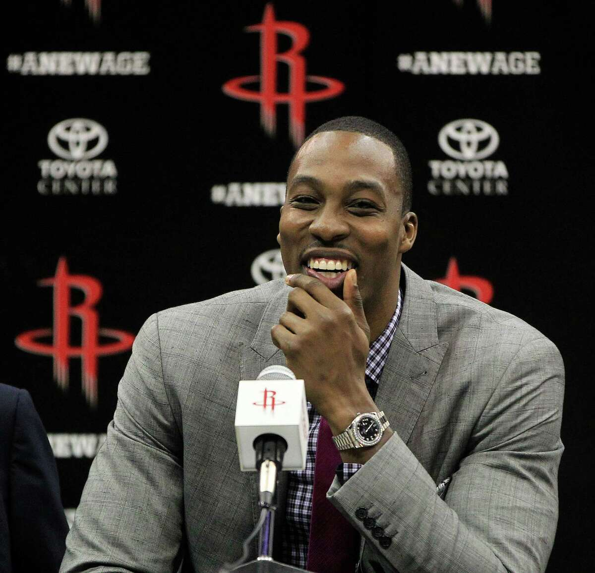 Houston Rocket's Dwight Howard smiles during the press conference and welcoming ceremony for him, Saturday, July 13, 2013, in Houston. ( Karen Warren / Houston Chronicle )
