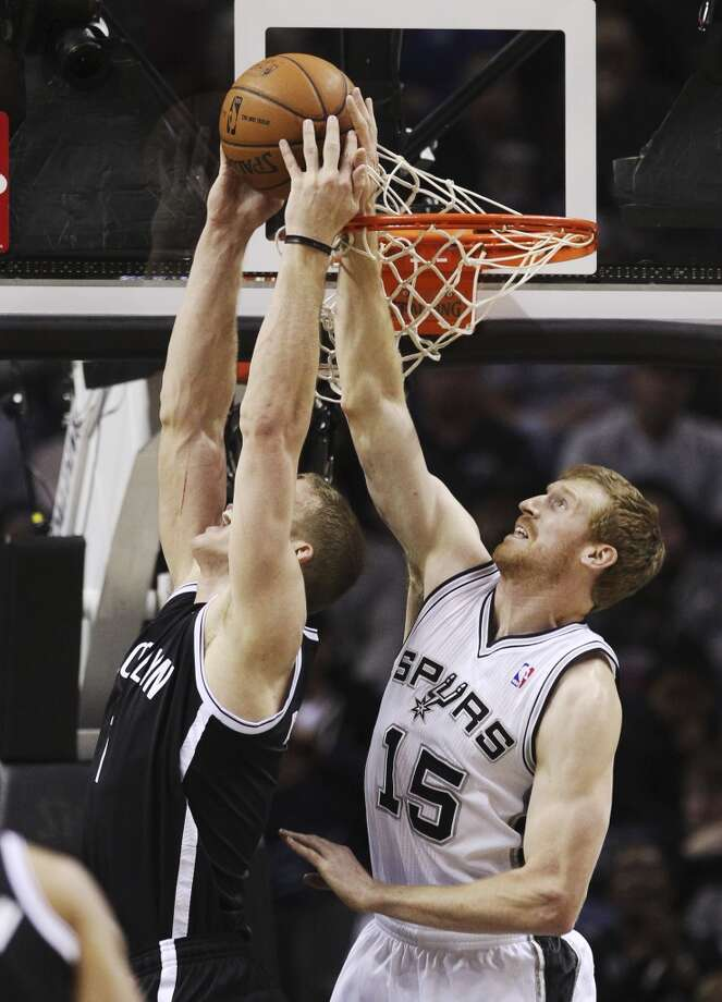 Spurs' Matt Bonner (15) attempts a block against Brooklyn Nets' Mason Plumlee (01) in the second half at the AT&T Center on Tuesday, Dec. 31, 2013. Spurs win 113-92. (Kin Man Hui/San Antonio Express-News) Photo: San Antonio Express-News