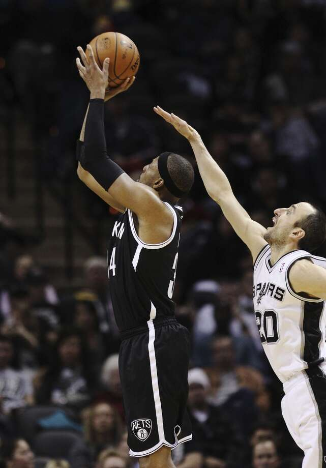 Spurs' Manu Ginobili (20) attempts to block a shot by Brooklyn Nets' Paul Pierce (34) in the second half at the AT&T Center on Tuesday, Dec. 31, 2013. Spurs win 113-92. (Kin Man Hui/San Antonio Express-News) Photo: San Antonio Express-News