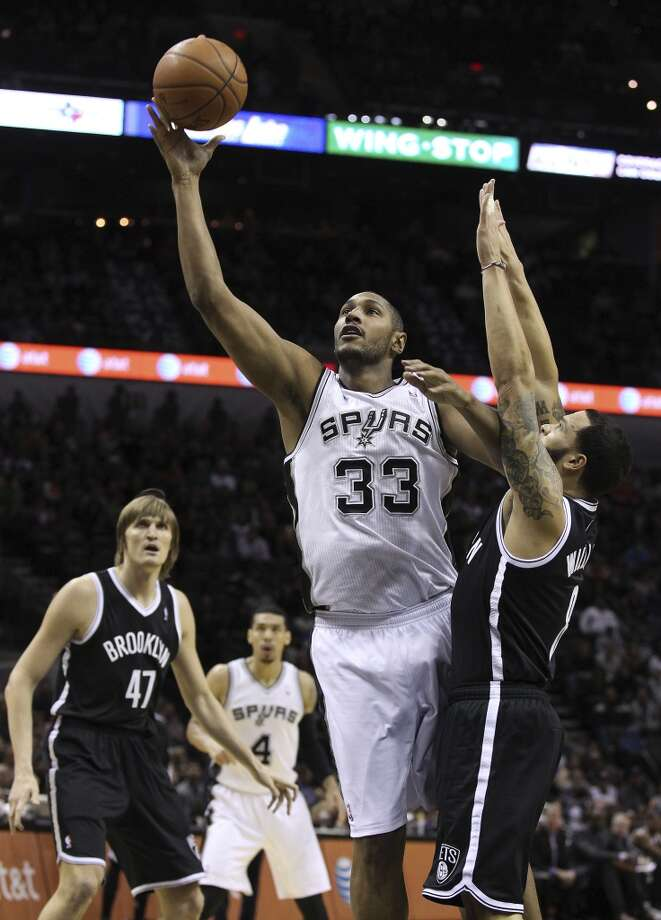 Spurs' Boris Diaw (33) takes a shot against Brooklyn Nets' Deron Williams (08) in the first half at the AT&T Center on Tuesday, Dec. 31, 2013. (Kin Man Hui/San Antonio Express-News) Photo: San Antonio Express-News