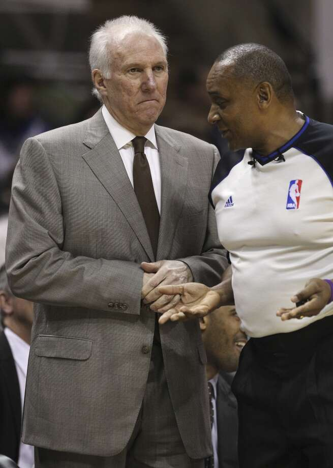 Spurs coach Gregg Popovich (left) and game official Eddie Rush discuss a call during the game against the Brooklyn Nets in the first half at the AT&T Center on Tuesday, Dec. 31, 2013. (Kin Man Hui/San Antonio Express-News) Photo: San Antonio Express-News