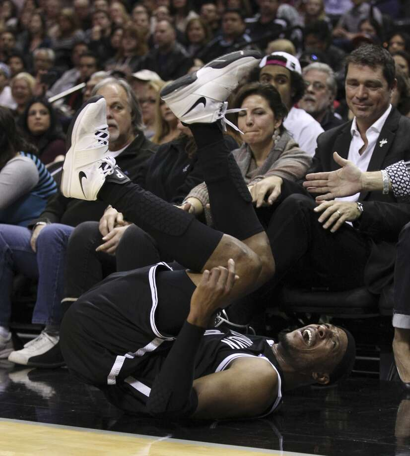 Brooklyn Nets' Paul Pierce (34) falls backwards while retrieving a errant pass in the first half at the AT&T Center on Tuesday, Dec. 31, 2013. (Kin Man Hui/San Antonio Express-News) Photo: San Antonio Express-News