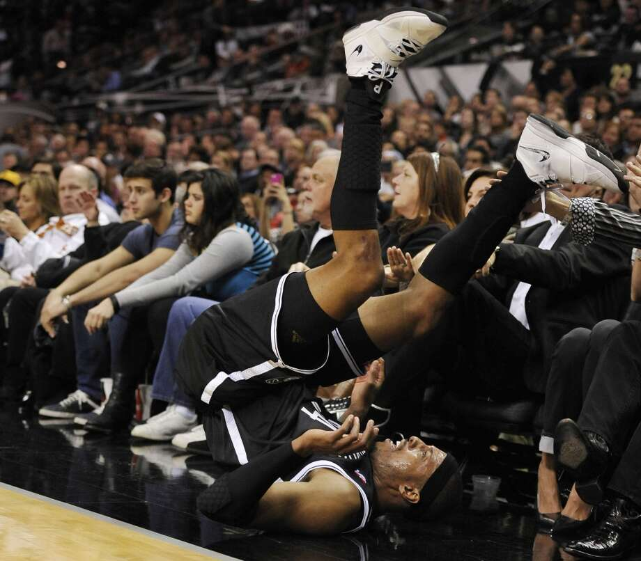 Brooklyn Nets forward Paul Pierce slides out of bounds during the first half of an NBA basketball game against the San Antonio Spurs on Tuesday, Dec. 31, 2013, in San Antonio. San Antonio won 113-92. (AP Photo/Darren Abate) Photo: Associated Press