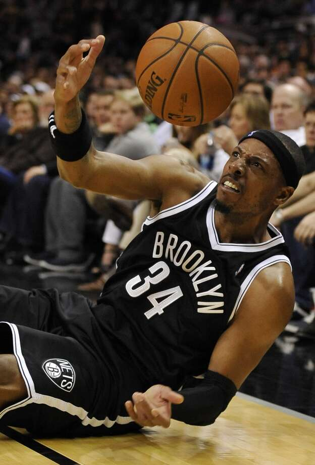 Brooklyn Nets forward Paul Pierce slides out of bounds as he chases the loose ball during the first half of an NBA basketball game against the San Antonio Spurs on Tuesday, Dec. 31, 2013, in San Antonio. (AP Photo/Darren Abate) Photo: Associated Press
