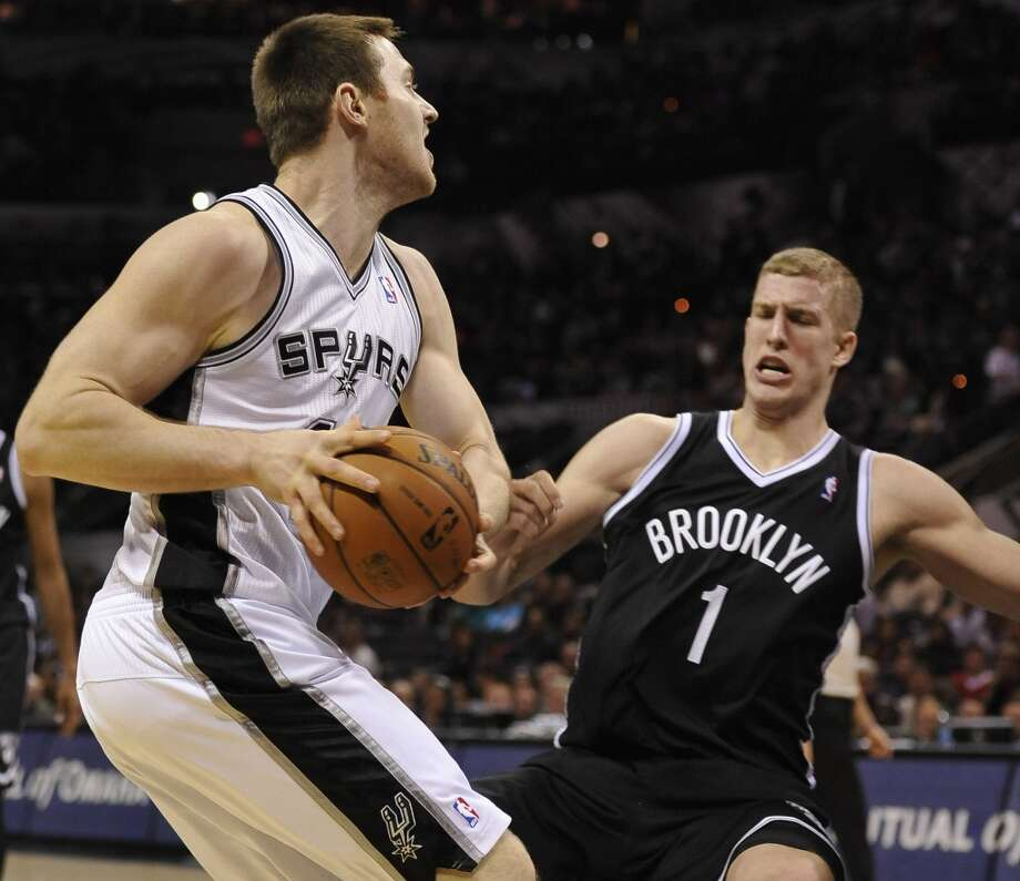 San Antonio Spurs forward Aron Baynes, left, of Australia, collides with Brooklyn Nets forward Mason Plumlee during the second half of an NBA basketball game on Tuesday, Dec. 31, 2013, in San Antonio. San Antonio won 113-92.(AP Photo/Darren Abate) Photo: Associated Press