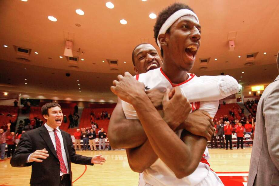 Houston guard Danrad Knowles (0) celebrates a victory after the second half of a basketball game between the University of Houston and the University of Connecticut Dec. 31, 2013 in Houston. Houston won 75-71. Photo: Eric Kayne, For The Chronicle / Eric Kayne
