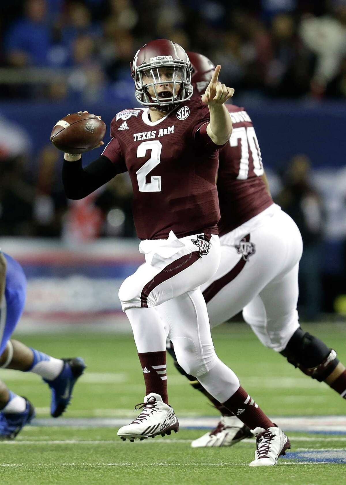 ATLANTA, GA - DECEMBER 31: Quarterback Johnny Manziel #2 of the Texas A&M Aggies points and looks downfield to pass during the the Chick-fil-A Bowl game against the Duke Blue Devils at the Georgia Dome on December 31, 2013 in Atlanta, Georgia.