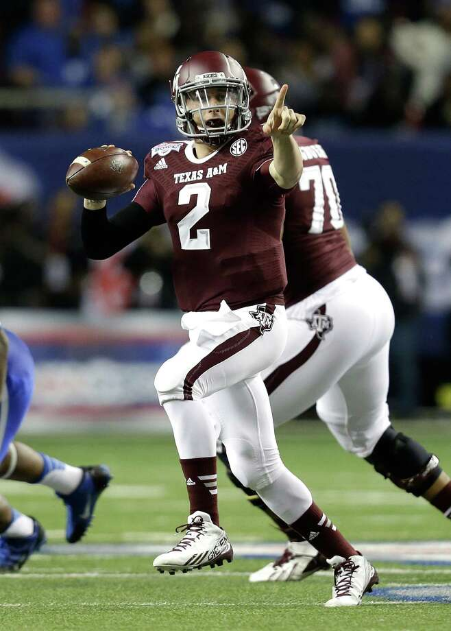 ATLANTA, GA - DECEMBER 31:  Quarterback Johnny Manziel #2 of the Texas A&M Aggies points and looks downfield to pass during the the Chick-fil-A Bowl game against the Duke Blue Devils at the Georgia Dome on December 31, 2013 in Atlanta, Georgia. Photo: Mike Zarrilli, Getty Images / 2013 Getty Images