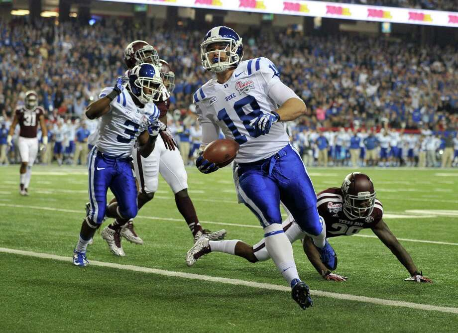 Duke Blue Devils quarterback Brandon Connette scores against the Texas A&M Aggies during the first quarter of the Chick-fil-A Bowl at the Georgia Dome in Atlanta on Tuesday, Dec. 31, 2013. (Brant Sanderlin/Atlanta Journal-Constitution/MCT) Photo: Brant Sanderlin, McClatchy-Tribune News Service / Atlanta Journal-Constitution