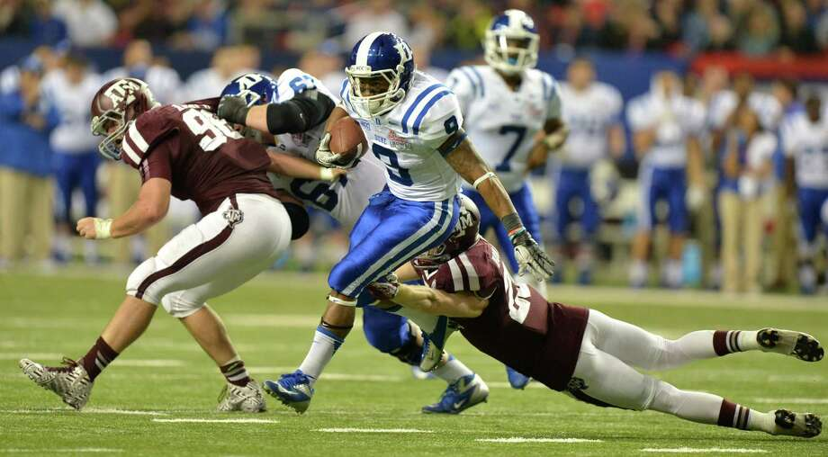 Duke Blue Devils running back Josh Snead breaks a tackle by Texas A&M Aggies defensive back Clay Honeycutt en route to a touchdown in the 2nd quarter of the Chick-fil-A Bowl at the Georgia Dome in Atlanta on Tuesday, Dec. 31, 2013. (Brant Sanderlin/Atlanta Journal-Constitution/MCT) Photo: Brant Sanderlin, McClatchy-Tribune News Service / Atlanta Journal-Constitution
