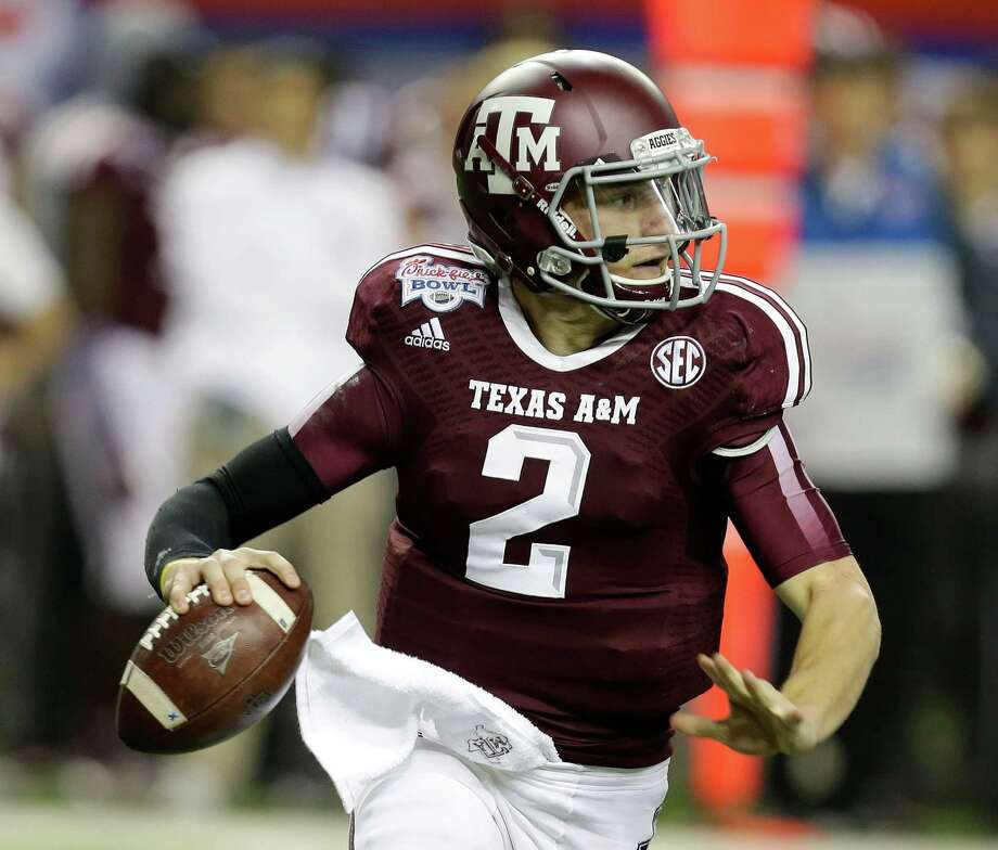 ATLANTA, GA - DECEMBER 31:  Quarterback Johnny Manziel #2 of the Texas A&M Aggies rolls out and looks downfield to pass during the the Chick-fil-A Bowl game against the Duke Blue Devils at the Georgia Dome on December 31, 2013 in Atlanta, Georgia. Photo: Mike Zarrilli, Getty Images / 2013 Getty Images