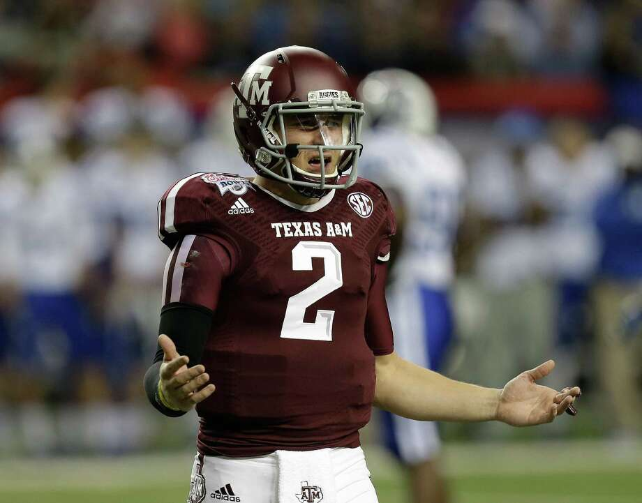 ATLANTA, GA - DECEMBER 31:  Quarterback Johnny Manziel #2 of the Texas A&M Aggies argues a call during the the Chick-fil-A Bowl game against the Duke Blue Devils at the Georgia Dome on December 31, 2013 in Atlanta, Georgia. Photo: Mike Zarrilli, Getty Images / 2013 Getty Images
