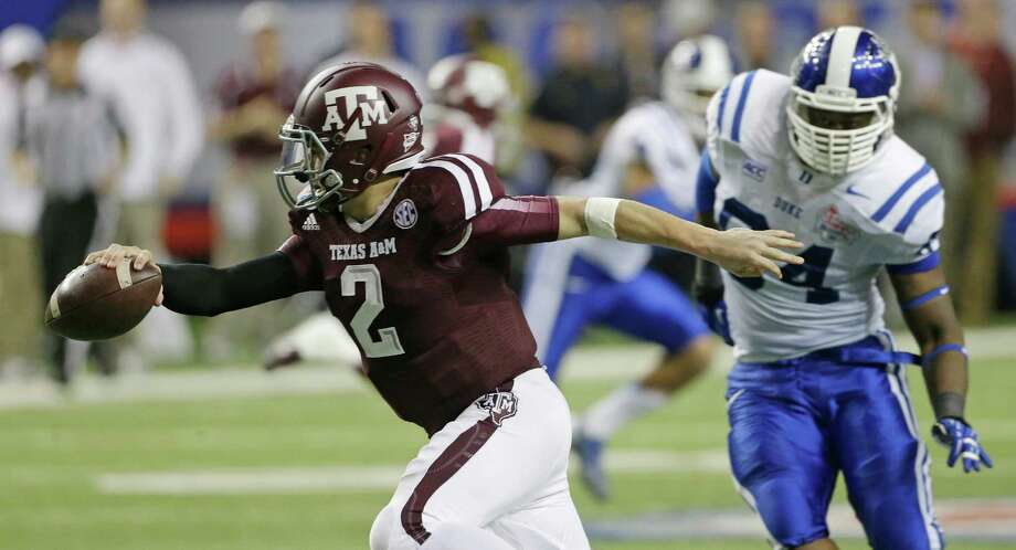 Texas A&M quarterback Johnny Manziel (2) is chased by Duke linebacker C.J. France (54) in the second half of the Chick-fil-A Bowl NCAA college football game Tuesday, Dec. 31, 2013, in Atlanta. (AP Photo/John Bazemore) Photo: John Bazemore, Associated Press / AP