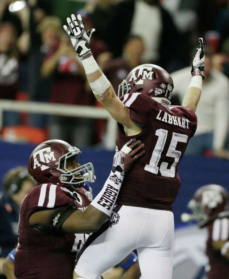 Texas A&M wide receiver Travis Labhart (15) celebrates his score against Duke in the second half of the Chick-fil-A Bowl NCAA college football game Tuesday, Dec. 31, 2013, in Atlanta. (AP Photo/John Bazemore) Photo: John Bazemore, Associated Press / AP